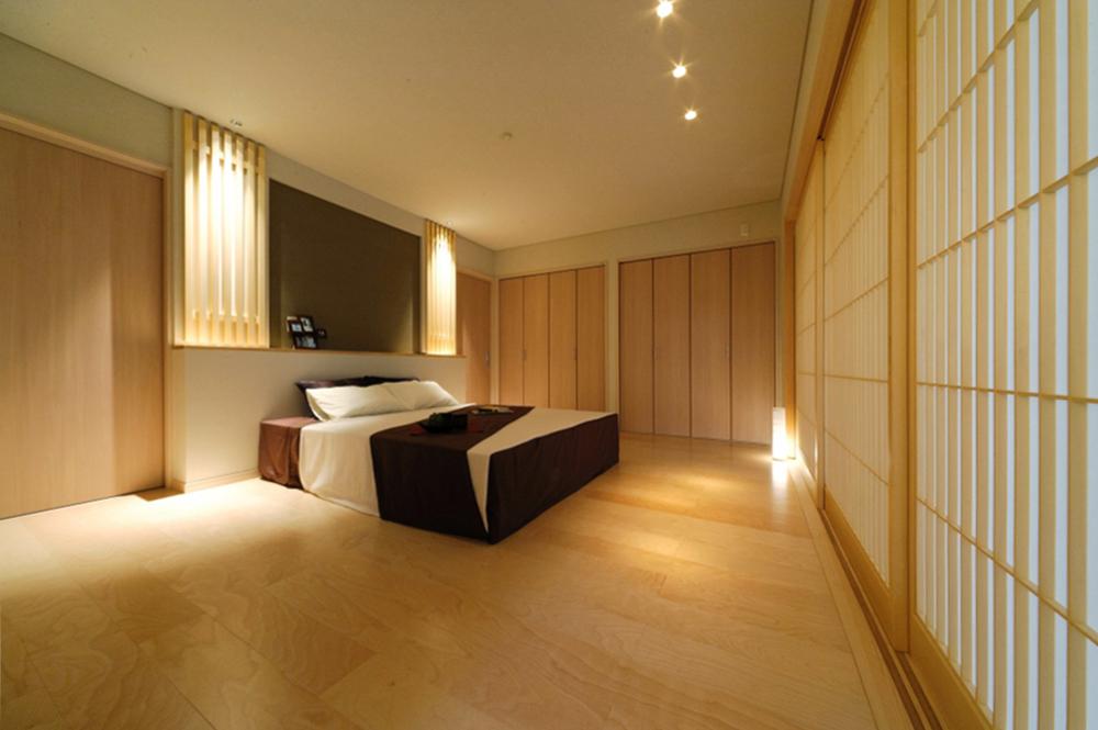 上質で落ち着いた寝室空間。の写真
